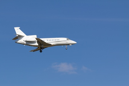 A private jet without any sign landing at Vienna airport photo