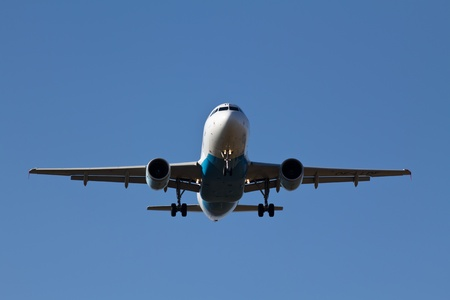 A plane landing on the airport of Vienna photo