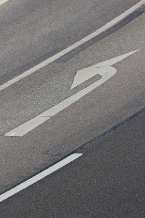 one lane street sign: A road sign to turn left on a road lane in the outskirts of Vienna Stock Photo