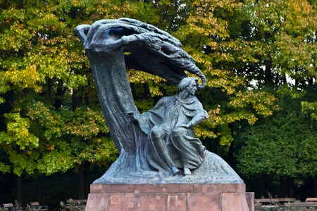 A statue of Frederic Chopin, the polish composer, in a park in Warsaw, Poland photo
