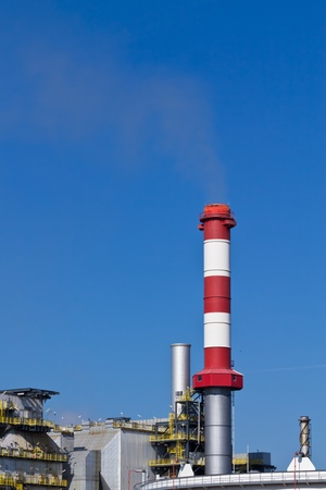 An industry chimney operating on a low level in an industrial area close to Vienna photo