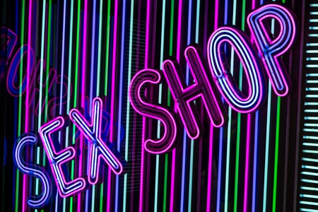 A neon sex shop sign in Madrid Imagens