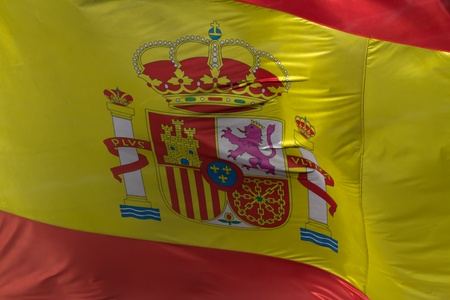 municipal: A large spanish flag waving on a municipal building in Madrid Stock Photo