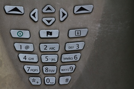 dial pad: A spanish number pad of a public telephone Stock Photo
