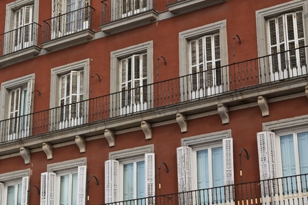 Open and closed windows on Plaza Mayor in Madrid photo