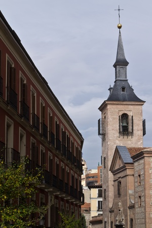 A spanish street in the center of Madrid with a church opposite a classical building Stock Photo - 11380091