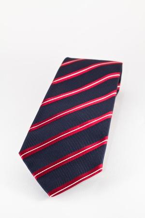 A single striped tie in the studio photo