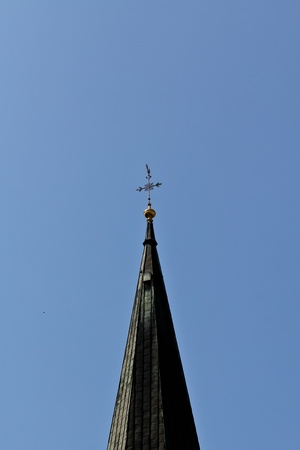 The top of a church tower in the center of Vienna, Austria photo