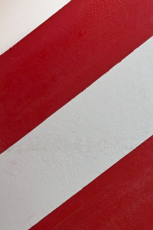 A red and white striped wall in the center of Madrid photo