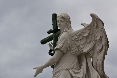 An angel with a serpent on its cross in front of Karlskirche in Vienna photo