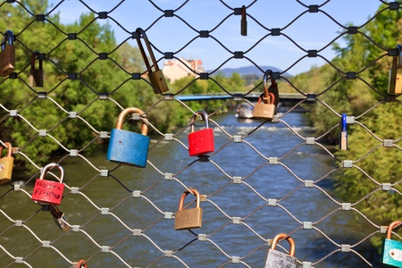Love locks on a bridge - a widespread habit of putting locks on public bridges - this time in Graz, Austria Stock Photo - 13514784