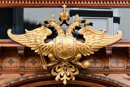 heads old building facade: A double headed eagle on a bakery in Graz, Styria, Austria
