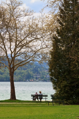 Two people sitting on a bench, talking about the future photo