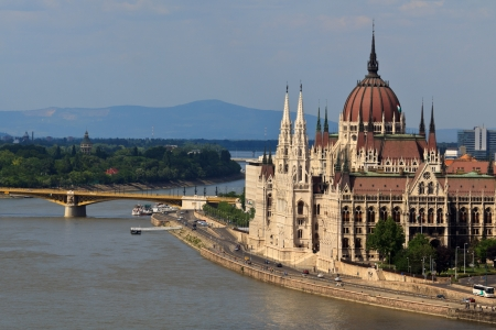 parliamentarian: The hungarian parliament next to the danube in Budapest, Hungary Stock Photo