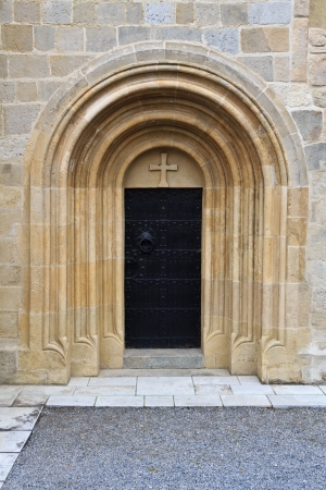 Side entrance to a small gothic church in Austria photo