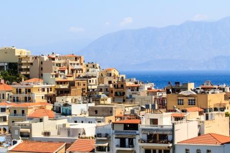 Greek buildings and their roofs in Agios Nikolaos, Crete, Greece photo