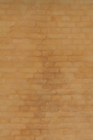 A yellow cracked brick wall in the kastellet of Copenhagen photo