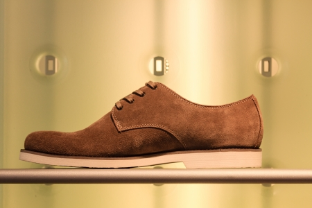 A suede shoe on display Stock Photo