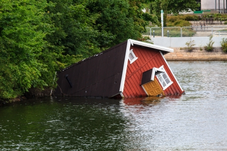 flood damage: A sunken house in a river of Malmö, Sweden