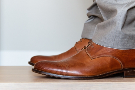 two floors: Worn elegant shoes from the side Stock Photo