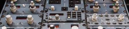 A control panel in an old and smaller commercial plane photo