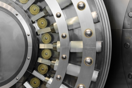 bank protection: An open safe door in a vault Stock Photo