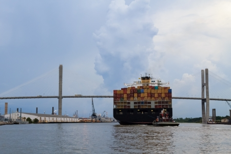 A huge cargo shipment on its way through the Savannah port and the memorial bridge, USA photo