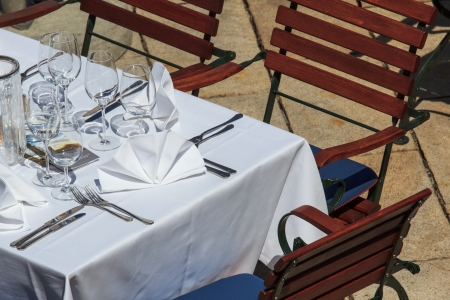 Set table on a restaurants terrace in Austria photo