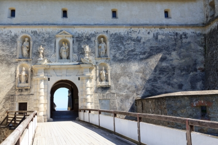 A bridge to an ornate gate of castle Forchtenstein photo