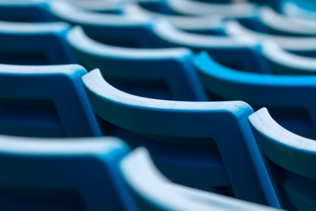 Seating rows in a stadium with weathered chairs Imagens