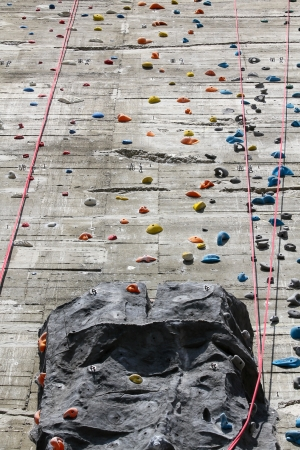 A segment of a climbing wall with a difficult pattern photo