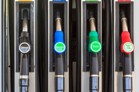 benzine: Four nozzles on a gas station in Austria, Europe offering diesel and super benzine Stock Photo