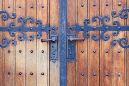 Wooden church door with metal ornaments of the Franciscan church in Maribor photo