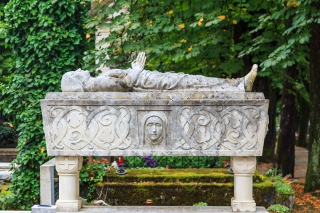 An ornate coffin with a sculpture above on Mirogoj cemetery in Zagreb, croatia photo