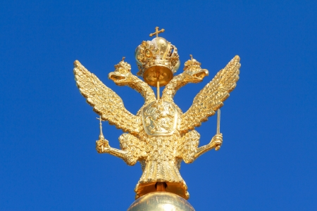 double headed: The russian national symbol, a double headed eagle, in gold Stock Photo
