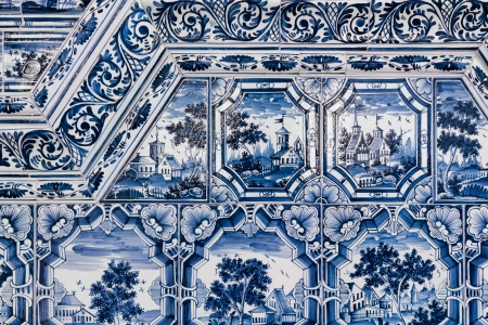 tiled stove: Detail of a tiled stove with blue and white paintings