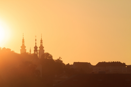 A cityscape of Prague at sunset photo