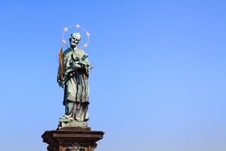 patron: Saint Nepomuk, patron of bridges on charles bridge over river Vltava at the spot where he was thrown into it Stock Photo