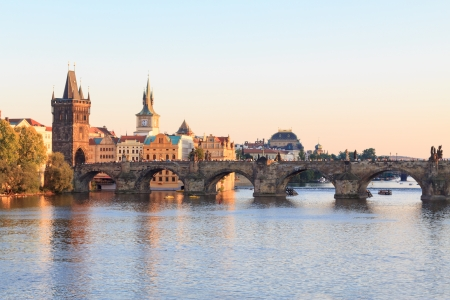 The famous Charles bridge in Prague at sunset photo
