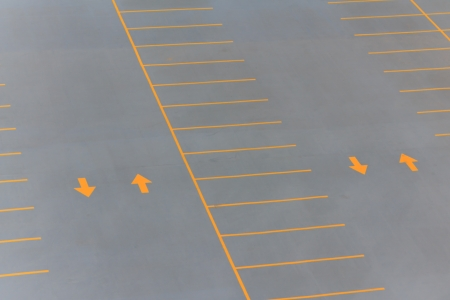 Back and forth on a parking lot with yellow arrows and lines