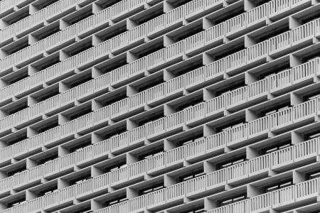 A symmetrical building facade with a repetitive pattern photo