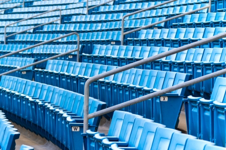 Seating rows in a stadium with weathered chairs Stock Photo