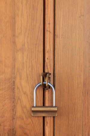 A wooden object closed by a padlock photo