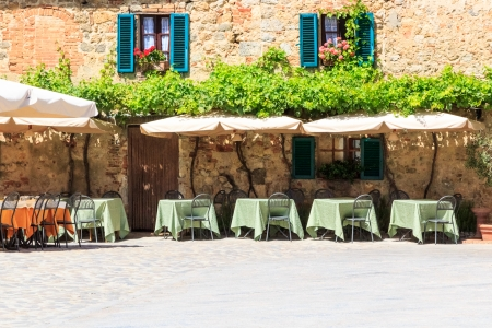 but: A restaurant in Monteriggioni with tables outside, but without any guests