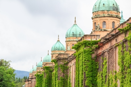 The walls and cupolas of Zagrebs Mirogoj cemetery covered with ivy photo