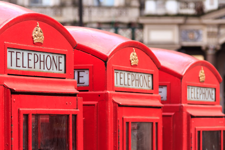 phonebooth: Three typical London red telephone booths next to each other