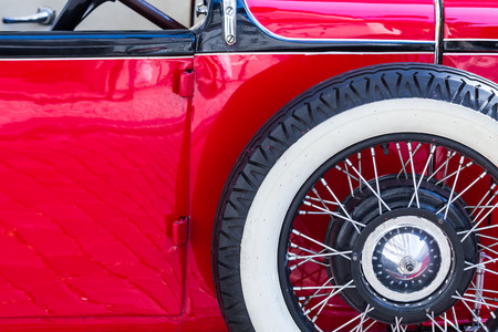 sidewall: Detail of a red oldtimer with a spare white sidewall tire Stock Photo