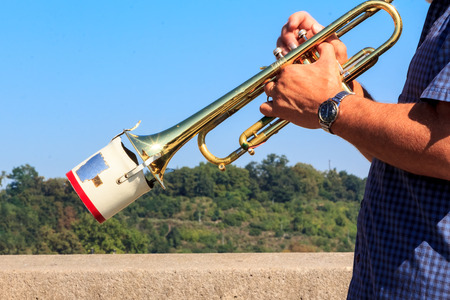 silencer: A trumpet played in open air with a metal muffler