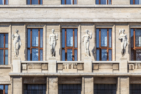 Four old greek statues of habits on an art nouveau building in Prague, Czech Republic photo
