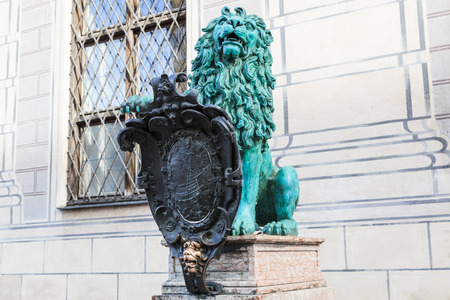 alte: Bronze heraldic lion in front of a royal building named Alte Residenz in Munich, Germany